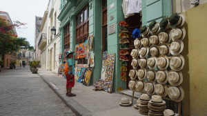 A kid outside a souvenir shop (these line the streets of Havana and offer hats, paintings, cigar holders, tshirts, etc)